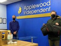 Nantwich firm Applewood Independent donates 12 laptops to school
