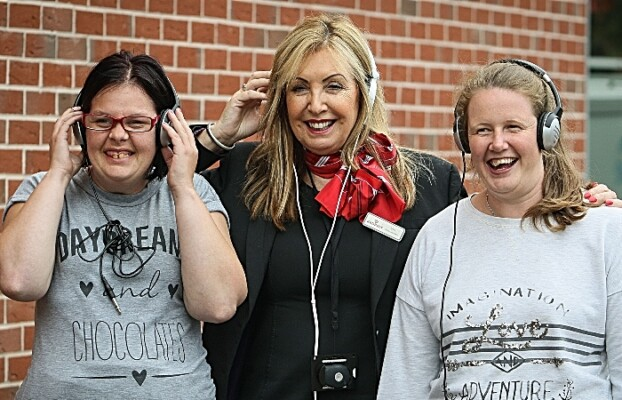 community grants - Redrow Nantwich Fund Sarah Speed and Charlotte Goodwin sing with Redrow's Sylvia Dixon -010 (1)