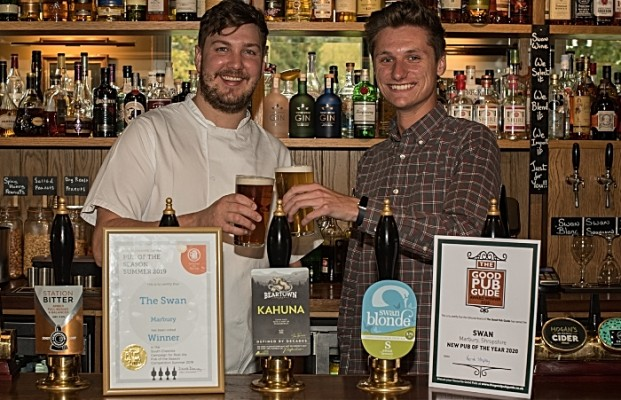 The Swan celebrates- chef Matt Marren and landlord Tom Morgan-Wynne raise a glass to the Good Pub Guide and Camra awards.