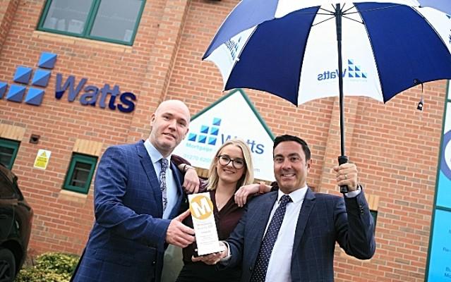 Watts management celebrate awards