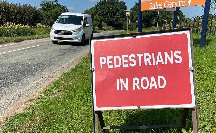 'PEDESTRIANS IN ROAD' roadside sign on Wistaston Green Road adjacent to Bellway 'Kingfisher Reach' housing development - July 2021 (1)