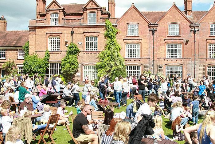 family festival - Visitors enjoying the sunshine on the main lawn
