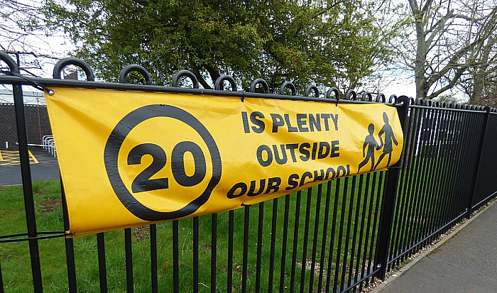 20 is Plenty banner outside school - limits - pic by Elliott Brown under creative commons licence