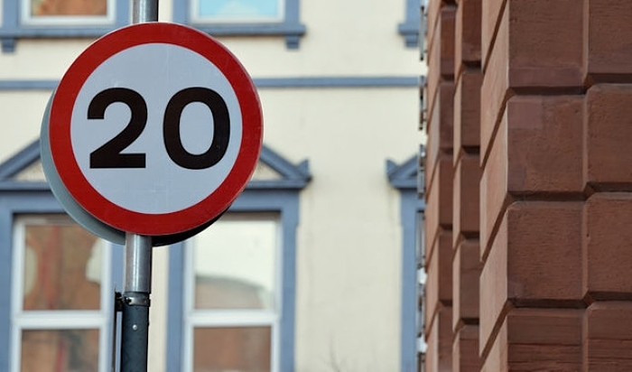 limit - 20 mph sign 20's Plenty - pic by Albert Bridge creative commons licence