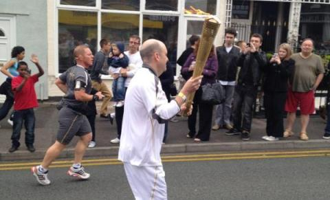 Thousands line rainy streets to see Olympic Torch in Crewe