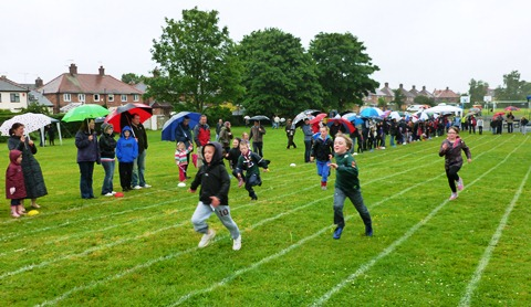 Hundreds brave rain for Willaston Jubilee and Rose Queen Fete