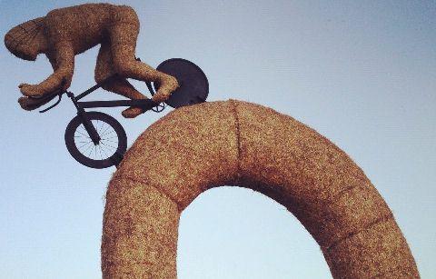 Snugburys unveil straw cyclist sculpture after Tour de France win