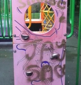 graffiti on play equipment at Joey the Swan park