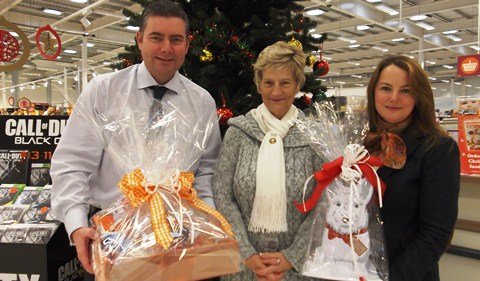 Nantwich store gives hamper prize to local cancer charity