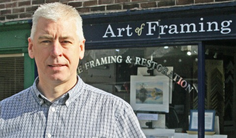 Nantwich shop owner in the picture for framing award