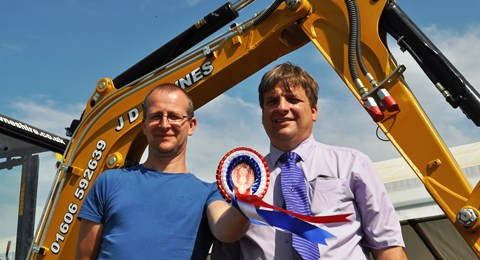 Adam Withnell and mark Towers with Caterpillar digger at Cheshire Show