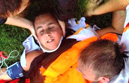 Kieran Flynn treated on pitch after breaking neck
