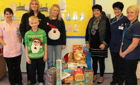 Caroline Cooper (General Manager) and Julie Butterfield (Payroll Administrator) from Cooper Buckley Haulage donate gifts to staff on CAU.