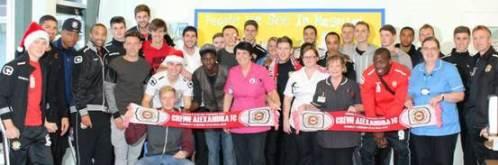 the Crewe Alex First Team Squad with CAU staff