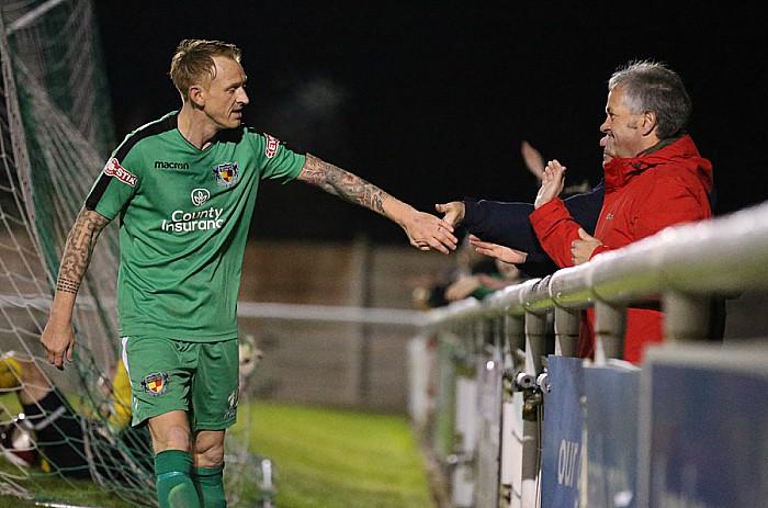 2nd goal - Steve Jones celebrates with a fan