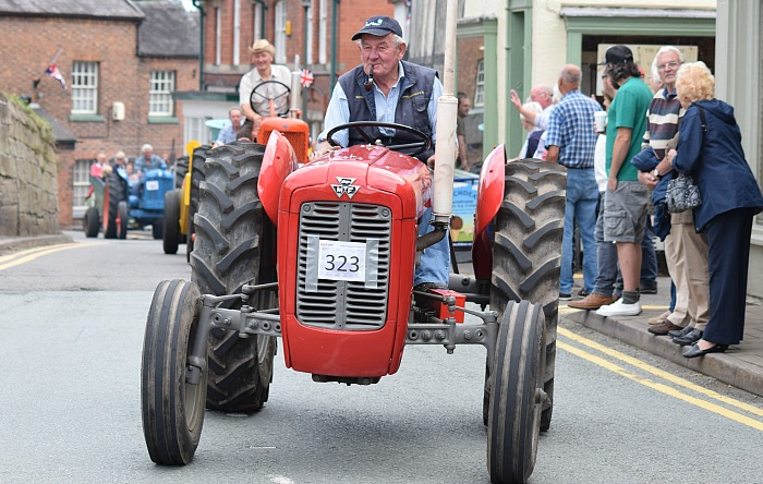 A Massey Ferguson tractor driver enjoys participating in the parade