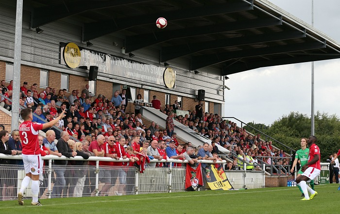 A Wrexham throw in in front of the Baker Wynne and Wilson Stand