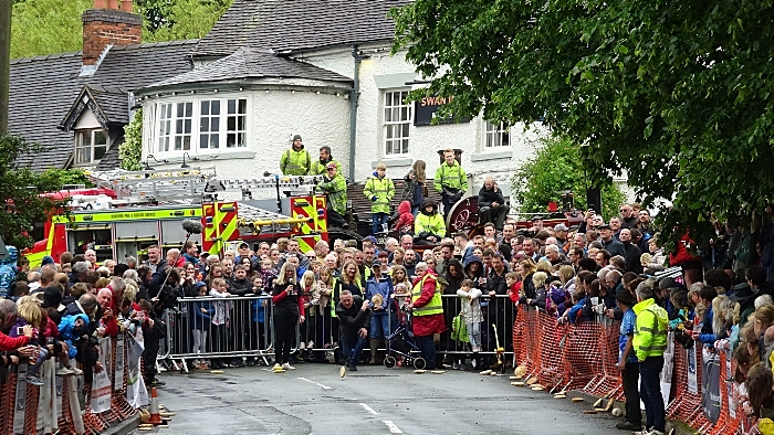 A competitor in the Adult race rolls on Main Road outside The Swan Inn (1)