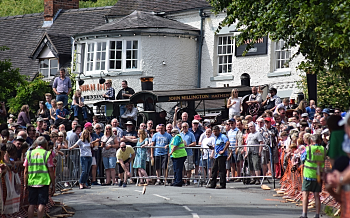 Fig pie - A competitor in the Adult race rolls outside the Swan Inn