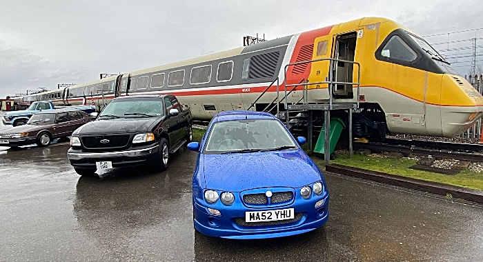 A selection of vehicles on display outside in front of the Advanced Passenger Train (1)