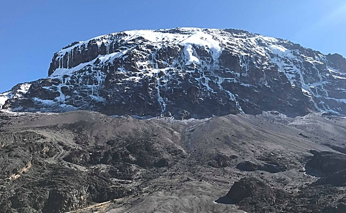 A view up towards the top of a snow-capped Mount Kilimanjaro