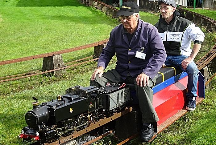 A visitor enjoys a miniature-gauge steam train ride (1)