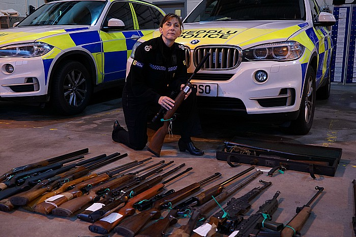 Acting Chief Constable Janette McCormick with firearms surrendered during campaign