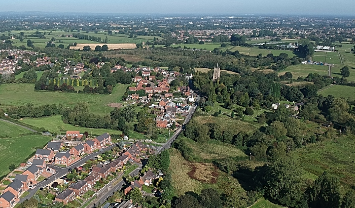 aerial view above tower and the village of wybunbury