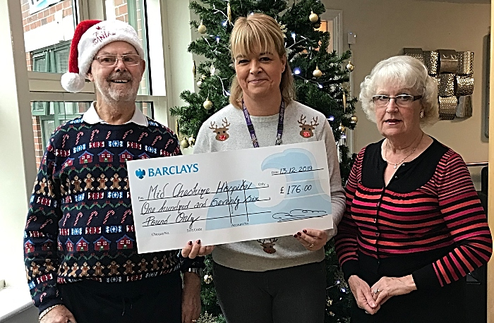 care home resident Alan Gibbs presents money to Mid Cheshire Hospital charity