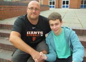 Alex Oultram congratulated by teacher Mr Falamarzi
