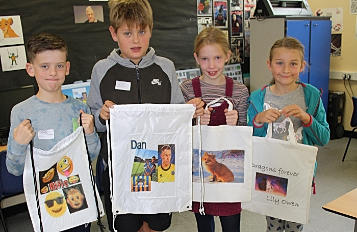 Alfie Bateman, Dan Pollard, Grace Davies and Lily Owen eagerly await to use their newly printed bags