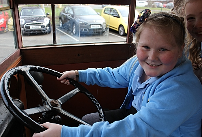 All aboard! Frankie Cliff tres her hand in the driver's seat of Mr Emerton's vintage bus (1)