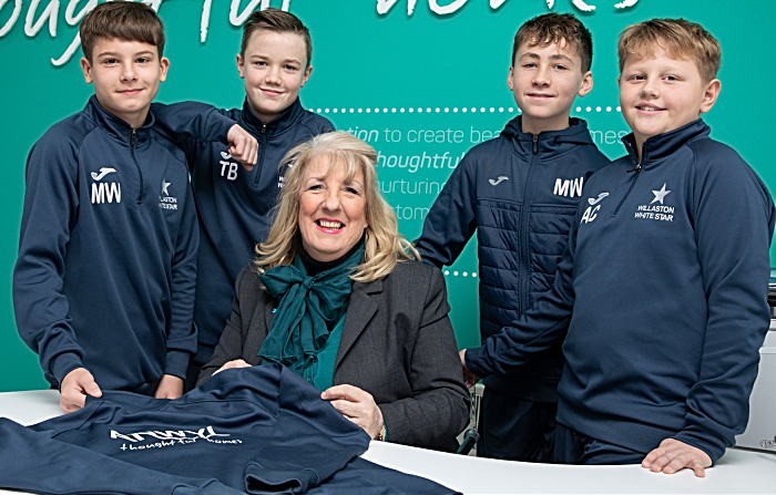 Anwyl Homes Sales advisor Julie Young with (LR) Max White, Thomas Bullock, Ellis Wright and Aiden Cope