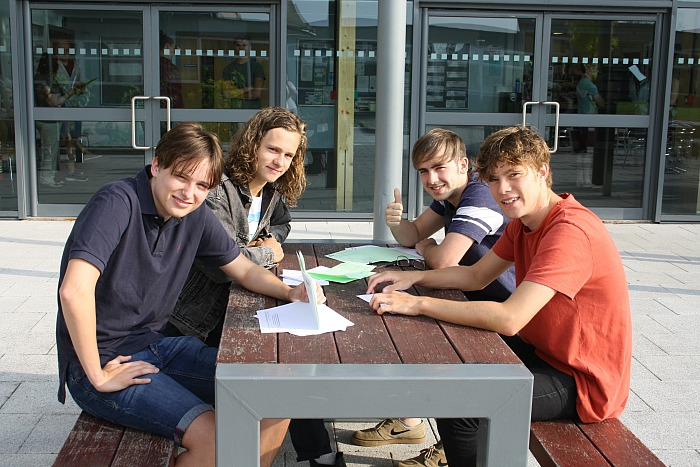 BL6 students Brad Stocking, James Howell-Jones, Callum Coleman and Osian Wolley compare grades and discuss future destinations