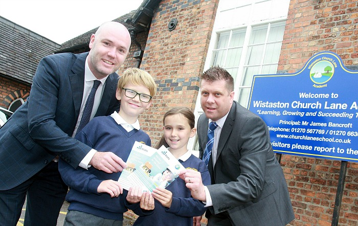 Barry Jones of Watts Mortgage and Wealth Management and his children Wilf and Lottie and Wistaston Church Lane Academy headteacher James Bancroft