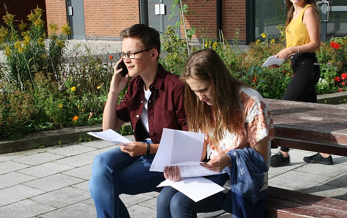 Ben Redfearn and Isabel Lloyd study their results and share the good news - GCSE results
