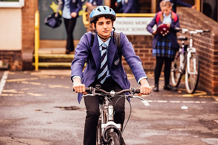 Boy cycling to school - transport and travel