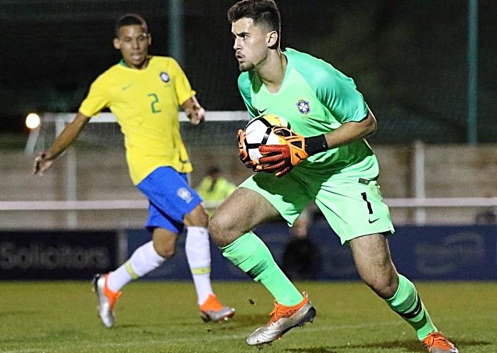Brazil keeper Gabriel Roberto Pereira confidentially holds the ball