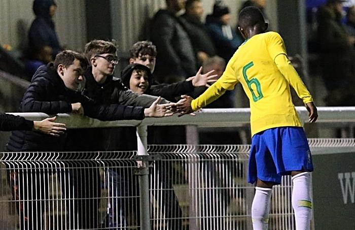Brazil player Eduardo Pinto de Jesus meets fans during a break in the action