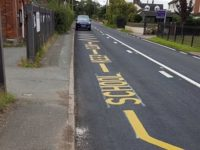 Highways staff paint 'keep clear' lines outside school closed 10 years ago