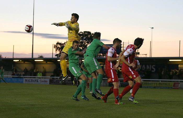Buxton goalkeeper Jan Budtz clears the ball