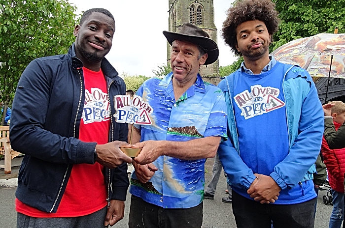 CBBC - Inel receives the All Over the Place trophy from Mark Walker Chairman Wybunbury Tower Preservation Trust for defeating an unhappy Johnny (1)