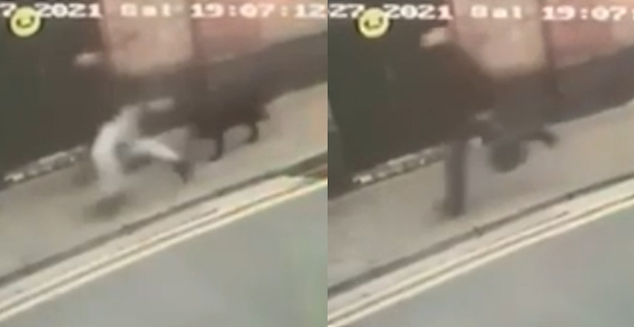 CCTV of men with dogs