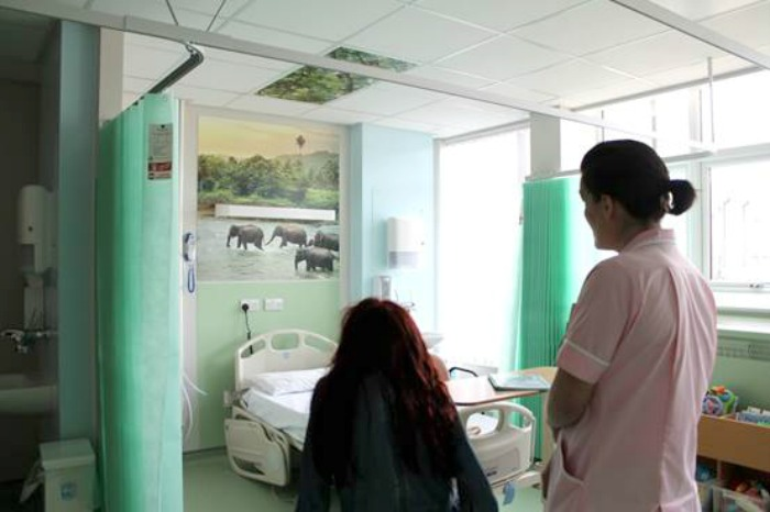 Caitlin Shaw (left) is given a tour of the refurbished children's ward during its official opening.