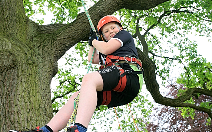 Callum Moore, aged 11, tries tree climing (1)