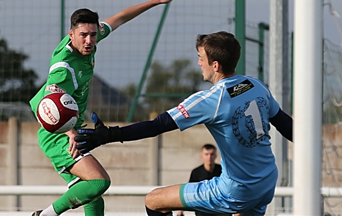 Callum Saunders effort is saved by Workington keeper Aaron Taylor (1)