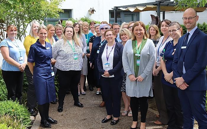 Cancer staff pictured in Leighton Hospital's Macmillan unit's garden
