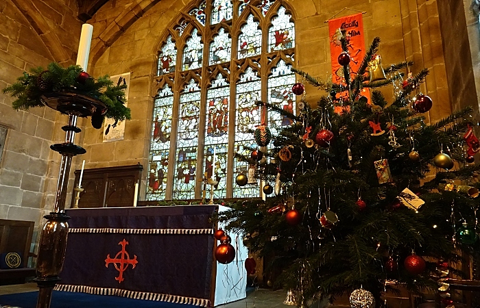 Candle decoration and decorated tree adjacent to the altar (1)