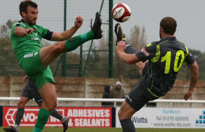 Captain Sam Hall challenges for the ball v Witton