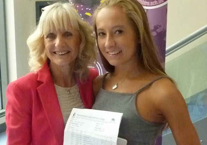 Cara Gibbons celebrating her GCSE results with Mrs Walker